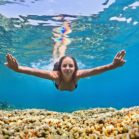 Young woman dive underwater